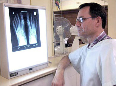 Dr. Reece Turner inspects a patients x-ray